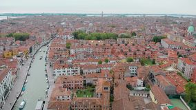 Aerial view of Venice in daytime, drone is flying over amazing italian city, red roofs and canal stock footage