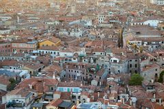 Aerial view of Venice roofs, city and buildings in Italy. Aerial view of Venice roofs, city and buildings before sunset in Italy royalty free stock photography