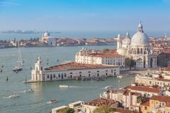 Aerial view of Venice, Santa Maria della Salute with Guidecca during early morning summer day. Royalty Free Stock Photo