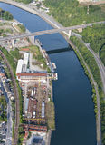 Aerial View : viaduct over a river near a shipyard. Aerial View : viaduct over a curved river near a shipyard Stock Photography