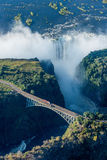 Aerial view of Victoria Falls behind bridge Stock Photos