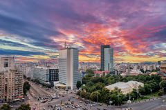 Aerial View of Victoria Square in Bucharest, Romania. Aerial View of Victoria Square at sunset after a summer storm. Vivid sky in Bucharest, Romania royalty free stock photography