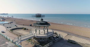Aerial view of the Victorian bandstand and the ruin of the West pier in Brighton and Hove stock footage