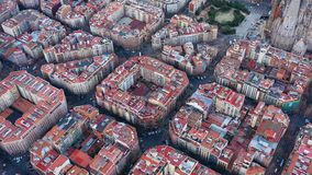 Aerial view video footage of residence districts in european city. Eixample district. Barcelona, Spain. Daytime. Car road traffic stock video footage