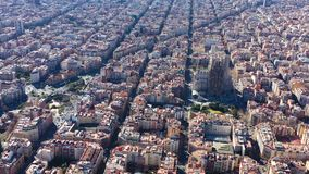 Aerial view video footage of residence districts in european city. Eixample district. Barcelona, Spain. Sagrada familia. Church. top view stock video footage