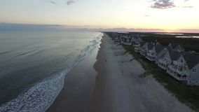 Aerial View / Video of the sun setting over North Topsail Beach and Carolina Inter-coastal Views stock video footage