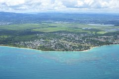 Aerial view of Vieques, Loiza, Puerto Rico. Aerial view of Caribbean coastline and urban town with mountains in background at Vieques, Loiza, Puerto Rico on stock photos