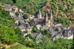 Aerial view of the village of Conques in Southern France. Rooftop view of the village of Coques in Southern France stock images