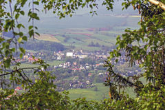 Aerial view of a village in the frame of branches Royalty Free Stock Photo