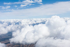 Aerial view of  the village landscape  over  the clouds Royalty Free Stock Photo