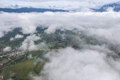 Aerial View of Village landscape and River over Clouds in Chiangdao , Thailand Stock Photo