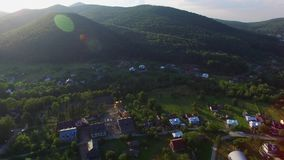 Aerial view village near forest and river stock footage