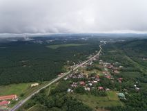 Aerial view of village and palm oil plantation royalty free stock photo