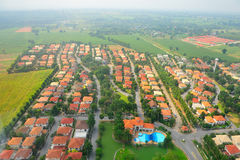 Aerial view of a village and pool Royalty Free Stock Images