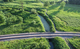 Aerial view of the village railway going across the bridge. royalty free stock image