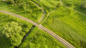 Aerial view of the village railway going across the bridge. Path Royalty Free Stock Images