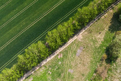 Aerial view of village road and harvest fields Stock Images