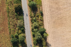 Aerial view of village road and harvest fields Stock Photography