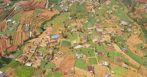 Aerial view of village and tea plantation in Sri Lanka. Drone footage stock footage