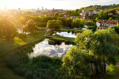Aerial view of Vilnius cityscape shot from Subaciaus viewpoint on sunset. Clouds reflecting in three ponds of Lithuania capital`s Stock Images