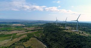 Aerial view of vines with Wind turbines Royalty Free Stock Photography