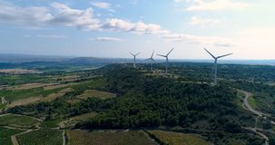 Aerial view of vines with Wind turbines Royalty Free Stock Photos