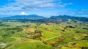 Aerial view on a vineyard and small farms at the foot of Mount Taranaki. Taranaki region, New Zealand