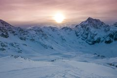Aerial view of vivid beautiful sunset over snowy ski resort. Solda Sulden, South Tyrol, Italy Stock Photo