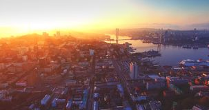 Aerial view of Vladivostok city center, Golden Horn harbour. Sunrise. Russia stock video footage
