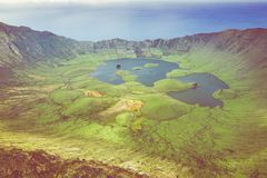 Aerial view of volcanic crater Caldeirao with a beautiful lake on the top of Corvo island. Azores islands, Portugal