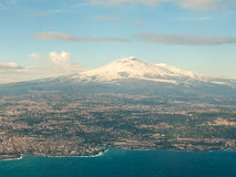 Aerial view of volcano Etna. Volcano Etna and surrounding towns as seen from an airplane during the winter Royalty Free Stock Photography