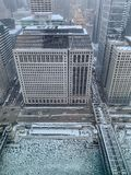 Aerial view of Wacker Drive, el tracks, and cracked ice on Chicago River royalty free stock images