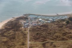 Aerial view Wadden Sea and marina at Dutch island Vlieland. Aerial view Marina with storage area at Dutch island Vlieland in Wadden sea royalty free stock images