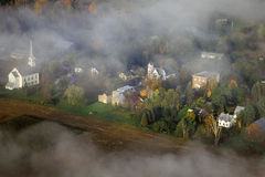 Aerial view of Waitsfield, VT in fog with church steeple on Scenic Route 100 in Autumn Stock Image