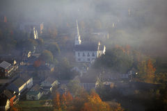 Aerial view of Waitsfield, VT in fog with church steeple on Scenic Route 100 in Autumn Stock Photo