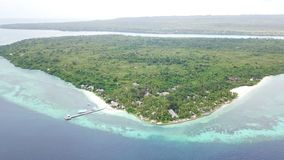 Aerial View of Wakatobi Dive Resort in Indonesia. A healthy coral reef fringes an island in Wakatobi National Park in Indonesia. This region harbors extremely stock video footage