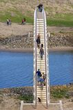 Aerial view of walking people on bridge in Nijmegen Stock Image