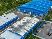 Aerial view of warehouse storages or industrial factory or logistics center from above. Aerial view of industrial buildings. And equipment machines, toned Royalty Free Stock Image