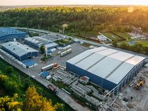 Aerial view of warehouse storages or industrial factory or logistics center from above. Aerial view of industrial buildings. And equipment machines, toned Royalty Free Stock Images