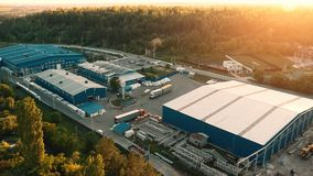 Aerial view of warehouse storages or industrial factory or logistics center from above. Aerial view of industrial buildings. And equipment machines at sunset royalty free stock images
