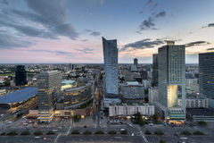Aerial view of Warsaw downtown at dusk time. Aerial view from Palace of Culture and Science with Golden Terraces shopping centre and Warszawa Centralna railway royalty free stock image