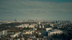 Aerial view of Warsaw suburbs and distant dowtown skyline on sunny spring day, Poland Stock Image