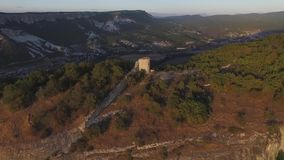 Aerial view on Watchtowers and defending walls and mountains. Shot. Lonely watchtower on the mountain. Ruined watchtower. Aerial view on Watchtowers and stock video footage
