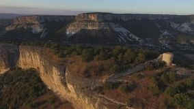 Aerial view on Watchtowers and defending walls and mountains. Shot. Lonely watchtower on the mountain. Ruined watchtower. Aerial view on Watchtowers and stock footage