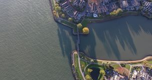 Aerial view of water and nature landscape, Walburg area, Dordrecht , Netherlands. Aerial view of water and nature landscape, houses, small island, Walburg area stock video