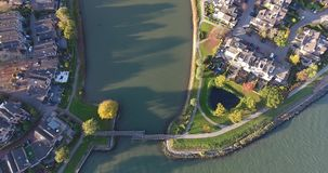 Aerial view of water and nature landscape, Walburg area, Dordrecht , Netherlands. Aerial view of water and nature landscape, houses, small island, Walburg area stock footage