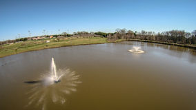 Aerial view of water pond aeration fountain Stock Images