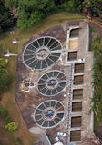 Aerial view of a water treatment plant. Water treatment plant aerial view showing cicular shape clarifiers and square filters Royalty Free Stock Photo