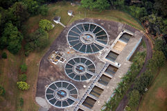 Aerial view of a water treatment plant2. Water treatment plant aerial view showing circular shape clarifiers and square filters Stock Photos