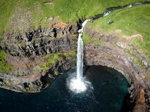 Aerial view of waterfall falling from the cliff into the sea, Denmark, Faroe Islands, Vagar Island, Gasadalur